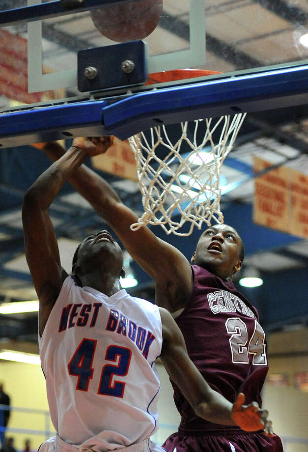 West Brook's Jjuan Hadnot attempts to lay up the ball against Central's E'Torrion Wilridge during a match up at the Bruin's gym Tuesday night. Photo taken Tuesday, November 20, 2012 Guiseppe Barranco/The Enterprise Photo: Guiseppe Barranco, STAFF PHOTOGRAPHER / The Beaumont Enterprise