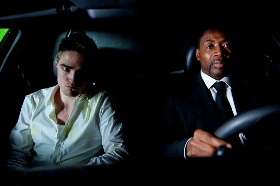 "Robert Pattinson, left, and Abdul Ayoola in ""Cosmopolis,"" the new film from David Cronenberg, in an undated handout image. The movie, which is due Aug. 17, 2012 from eOne, is an adaptation from the Don DeLillo novel. (Entertainment One via The New York Times) Photo: ENTERTAINMENT ONE / ENTERTAINMENT ONE"