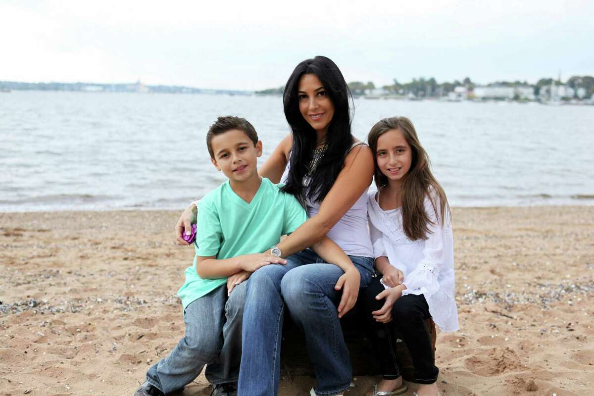 Lora Warnick, of New Milford, took this photo of Carla Facciolo, of ìMob Wivesî fame, and her 10-year-old twins, Joseph and Carmen.