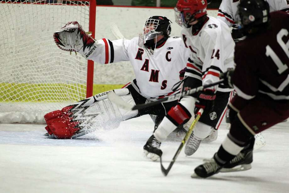 New Canaan Rams goalie Chrisopher Koennecke watchs in vain as a shot by Vin Fasulto finds the mark in a 2-2 overtime tie against North Haven in Darien on Tuesday afternoon. The goal was the first of the game. Photo: J. Gregory Raymond / Stamford Advocate Freelance;  © J. Gregory Raymond
