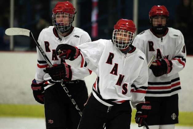 New Canaan's Davis Bruch (center) celebrates the second goalof the game  for New Canaan in a tightly fought battle against North Haven High School on Tuesday afternoon. The two squads went toe to toe in a 2-2 overtime tie. Photo: J. Gregory Raymond / Stamford Advocate Freelance;  © J. Gregory Raymond