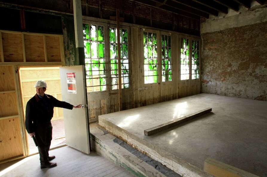 Architect Joseph Rozier looks through the interior of the Hendley Building. He will oversee the reha