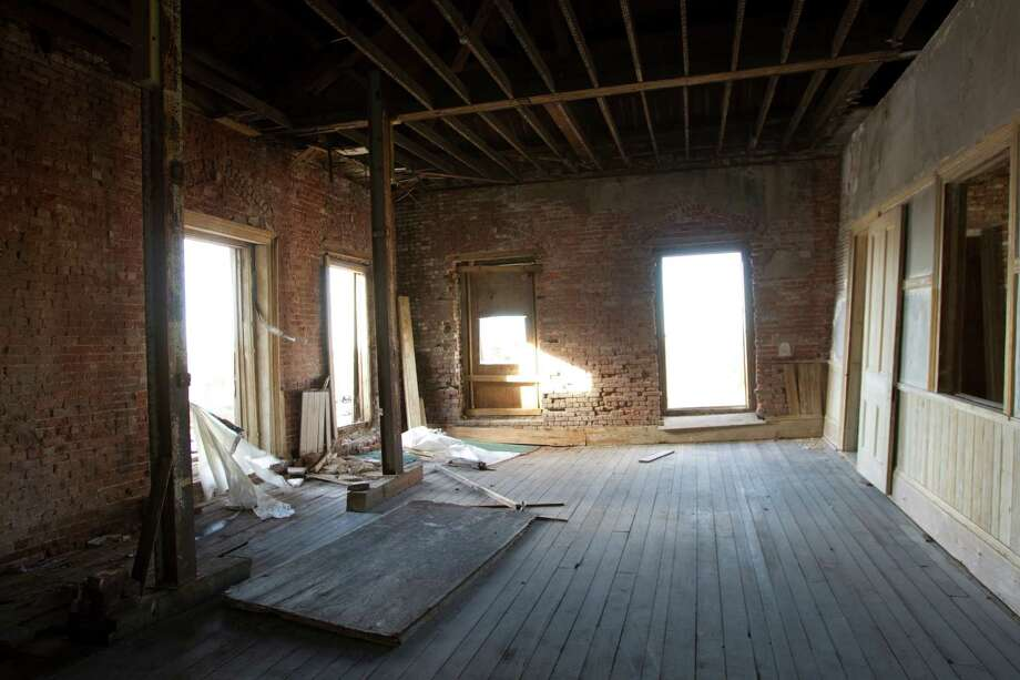 The interior of the Hendley Building is shown in Galveston. Four buildings unified by a joint front wall, the Hendley, located at Strand and 20th, is thought to be the island city's oldest surviving commercial structure.  Photo: Brett Coomer, Houston Chronicle / © 2012 Houston Chronicle