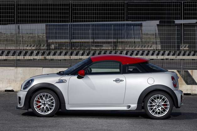 "2013 Mini Cooper Coupe: Mini decided less could be more as it ditched two seats for its Mini Cooper Coupe. What KBB said: ""Mini subtracted two seats and added even more style and agility to create what is essentially a go-kart for adults.""