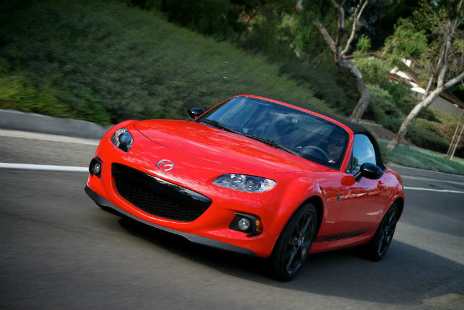 """2013 Mazda Miata MX-5: The Miata debuted 25 years ago, but it still packs the performance and agility. What KBB said: """"You can't have much more fun – especially within the confines of public roads – than you can in Mazda's now-legendary little roadster.""""Base Price: $24,515 Photo: Mazda"""
