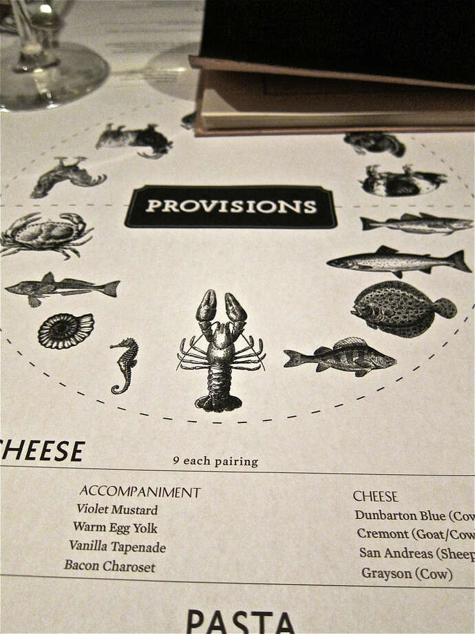 Over-sized menus serve as table coverings at The Pass & Provisions.
