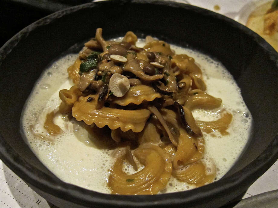 Cresta di gallo (rooster's comb) pasta with hen of the woods mushroom, toasted yeast and parmesan foam at Provisions.