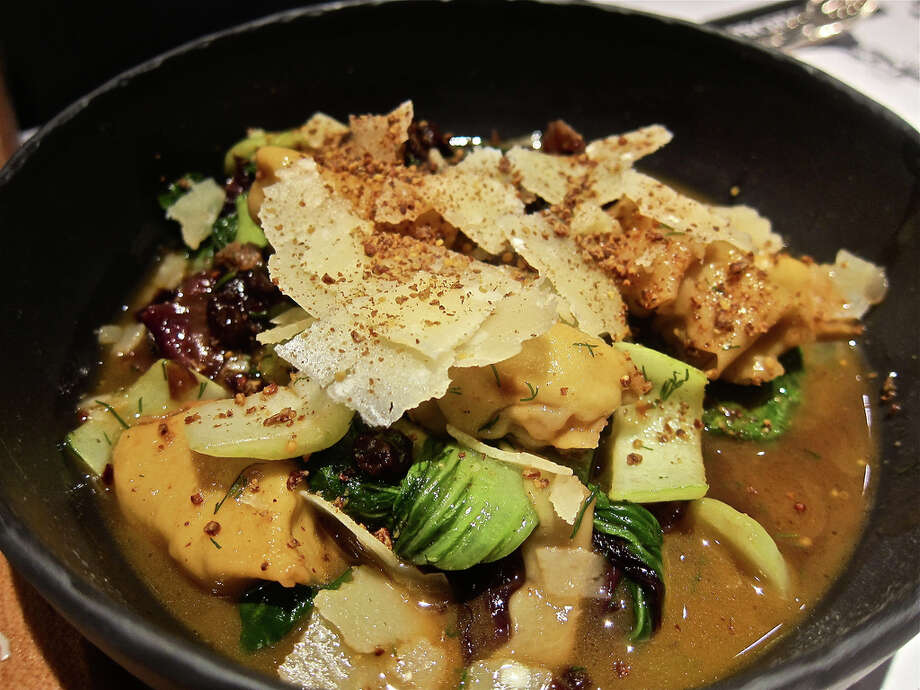 Agnolotti stuffed with ground salumi with bok choi at Provisions.
