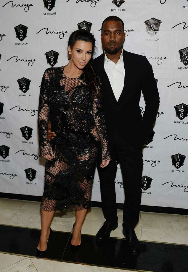 A reader takes the Express-News to task for running what he considers a meaningless story about Kim Kardashian and Kanye West. Photo: Denise Truscello, Getty Images / 2012 Getty Images