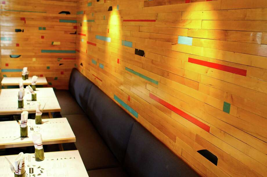 The Potato Tallegio wood paneling is made from recycled basketball courts. Photo: Nick De La Torre, Houston Chronicle / © 2012  Houston Chronicle