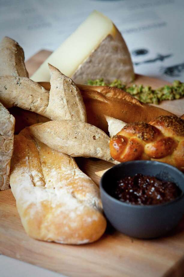 A tray of various breads, with its meat and cheese pairings. Photo: Nick De La Torre, Houston Chronicle / © 2012  Houston Chronicle