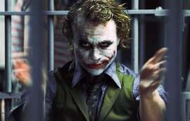 "In this image released by Warner Bros., Heath Ledger starring as The Joker, is shown in a scene from ""The Dark Knight.""   (AP Photo/Warner Bros. Pictures, Stephen Vaughan)"
