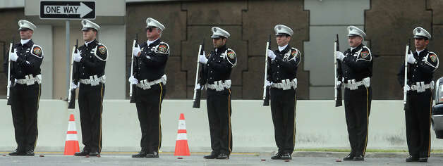 The San Antonio Police Honor Guard lines up for a gun salute Wednesday January 2, 2013 in the parking lot of Porter Loring Mortuary on McCollough during services for San Antonio Police Officer Edrees Mukhtar. Mukhtar,28, had been hospitalized since a December 10 on-duty car crash and died last Saturday evening. Photo: JOHN DAVENPORT, San Antonio Express-News / ©San Antonio Express-News/Photo Can Be Sold to the Public