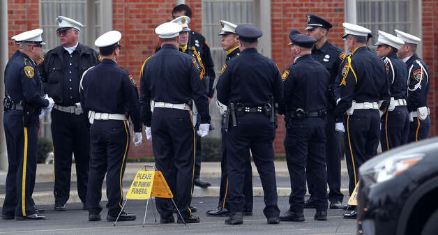 Police officers gather during the funeral service for San Antonio police officer Edrees Mukhtar at Porter Loring Mortuary on McCollough Wednesday January 2, 2013. Mukhtar,28, had been hospitalized since a December 10 car crash and died Saturday evening. Mukhtar had been with the police department for 18 months. Photo: JOHN DAVENPORT, San Antonio Express-News / ©San Antonio Express-News/Photo Can Be Sold to the Public