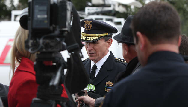 San Antonio Police Chief William McManus (center) speaks with the media after the funeral service for San Antonio police officer Edrees Mukhtar at Porter Loring Mortuary on McCollough Wednesday January 2, 2013. Mukhtar,28, had been hospitalized since a December 10 car crash and died Saturday evening. Mukhtar had been with the police department for 18 months. Photo: JOHN DAVENPORT, San Antonio Express-News / ©San Antonio Express-News/Photo Can Be Sold to the Public