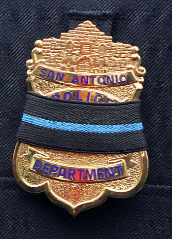 San Antonio Police Chief William McManus wears a badge with a black band while speaking with the media after the funeral service for San Antonio police officer Edrees Mukhtar at Porter Loring Mortuary on McCollough Wednesday January 2, 2013. Mukhtar,28, had been hospitalized since a December 10 car crash and died Saturday evening. Mukhtar had been with the police department for 18 months. Photo: JOHN DAVENPORT, San Antonio Express-News / ©San Antonio Express-News/Photo Can Be Sold to the Public