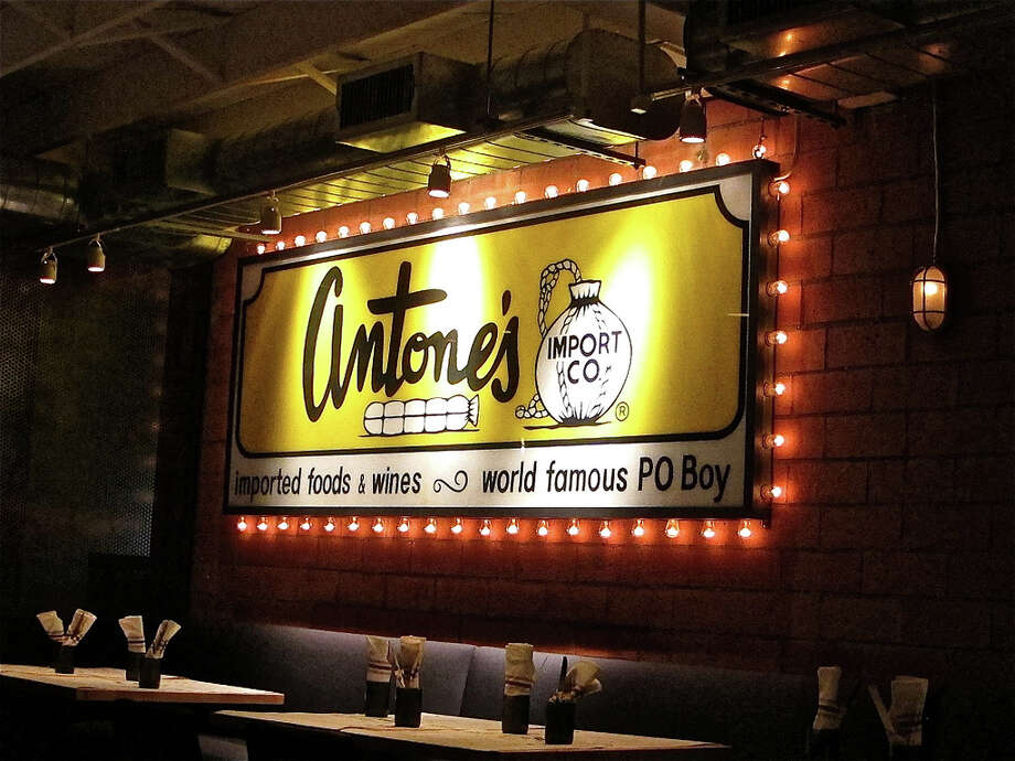 Vintage sign from the original Antone's Import Co. sets the tone in the Provisions dining room.