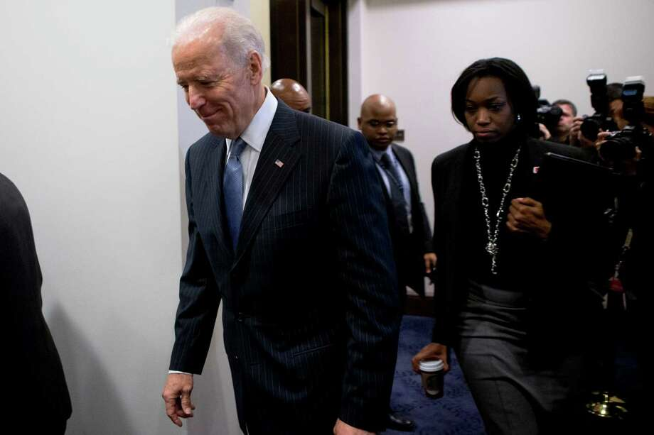 U.S. Vice President Joe Biden arrives to a House Democratic caucus meeting at the U.S. Capitol in Washington, D.C., U.S., on Tuesday, Jan. 1, 2013. The U.S. Senate passed a bipartisan budget deal two hours after income tax cuts expired, reaching an after-deadline agreement to undo the potential economic harm of $600 billion in tax increases and spending cuts. Photographer: Andrew Harrer/Bloomberg *** Local Caption *** Joe Biden Photo: Andrew Harrer, Bloomberg / © 2013 Bloomberg Finance LP