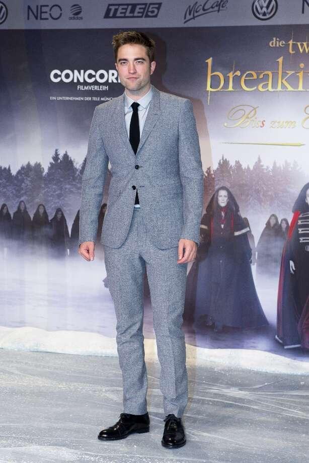 Actor Robert Pattinson attends the German premiere of The Twilight Saga: Breaking Dawn Part II in Berlin, Friday, Nov. 16, 2012. (AP Photo/Markus Schreiber) Photo: Markus Schreiber, ASSOCIATED PRESS / AP2012