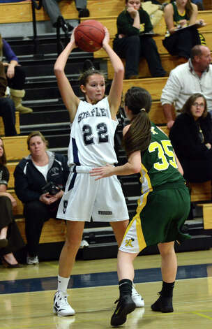 Staples' Nikki Bukovsky (22) looks to pass as Trinity Catholic's Nicole Fay (35) defends during the girls basketball game at Staples High School on Tuesday, Dec. 20, 2011. Photo: Amy Mortensen / Connecticut Post Freelance