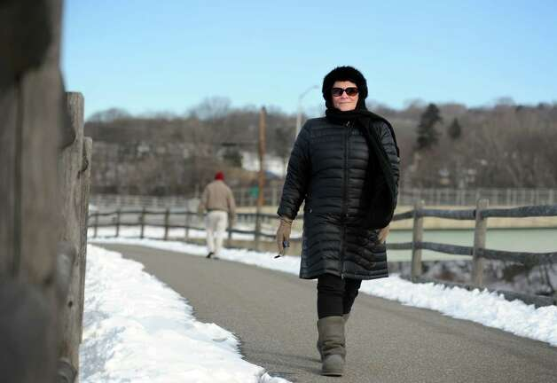 Kathy Bartley, of Derby, walks along the Housatonic River at the Derby Greenway Wednesday, Jan. 2, 2013  despite freezing temperatures. Photo: Autumn Driscoll / Connecticut Post