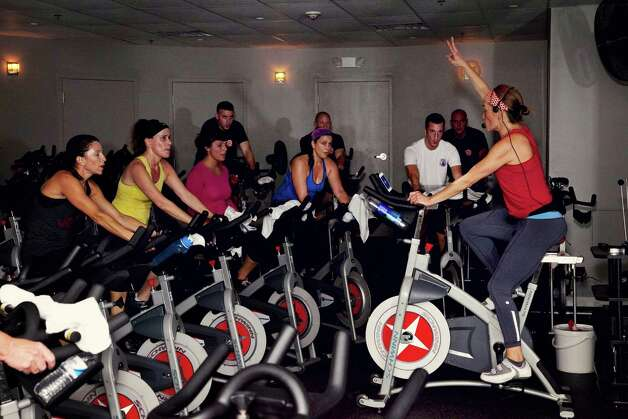 JoyRide Cycling Studio co-owner and lead instructor Rhodie Lorenz leads a fundraising ride on October 27, 2012 at the studioâÄôs Westport, Conn. location, benefiting the Westport Fire Department's efforts to raise money for lung disease research.  Lorenz and her co-owners, Amy Hochhauser and Debbie Katz, are planning to open a Darien, Conn. studio in June, 2013. Photo: Contributed Photo / Stamford Advocate Contributed