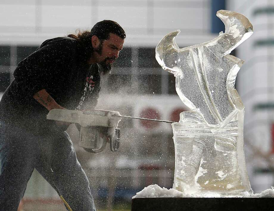 "The Reverend Butter, ""Rolando De La Garza"" carves the Houston Texans mascot, Toro, into a 300-pound piece of ice at Discovery Green, Friday, Jan. 6, 2012, in Houston, as he warms up for the Stella Artois Dirty Dozen: 4th Annual Ice Sculpting Competition. Photo: Karen Warren, Staff / © 2012  Houston Chronicle"