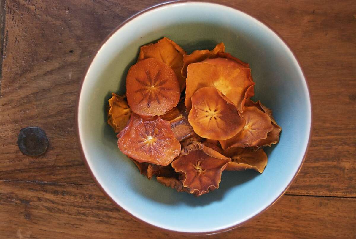 Preserving: Last holiday season, a couple of friends and I spent an evening slicing persimmons from one of their trees and dehydrating them. It s a mundane task but a satisfying one, and we made it cozy with wine and candlelight. It s the perfect winter activity.