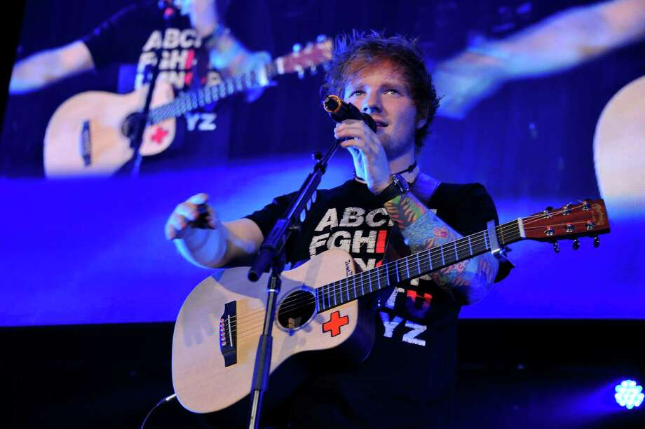"Ed Sheeran: The English singer-songwriter's ""+"" was one of the year's 