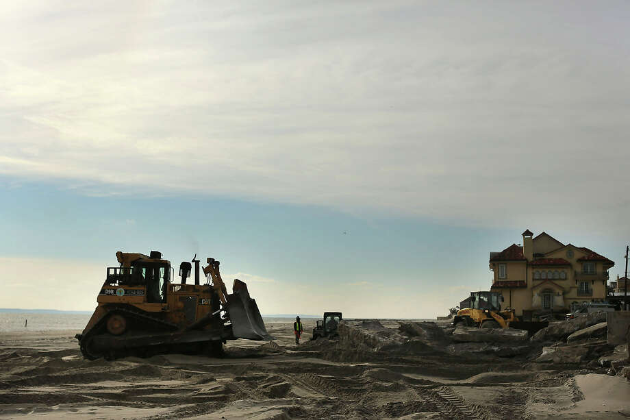 Construction of a new sea wall begins along the beach in the Belle Harbor neighborhood in the Rockaways on January 2, 2013 in the Queens borough of New York City. Criticism, including by President Barack Obama, has been directed at the Republican House's decision to adjourn without passing a Hurricane Sandy aid bill. According to early estimates, Hurricane Sandy inflicted at least $50 to $60 billion in damage across the Northeast, making it one of the most destructive storms ever. Photo: Spencer Platt, Getty Images / 2013 Getty Images