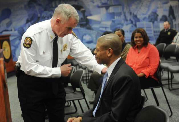 Greenwich Police Chief James Heavey, left, spoke with new police officer Alberto E. Escoffery before swearing-in by First Selectman Peter Tesei at Greenwich Town Hall in Greenwich, Conn., Wednesday, Jan. 2, 2013. Photo: Helen Neafsey / Greenwich Time