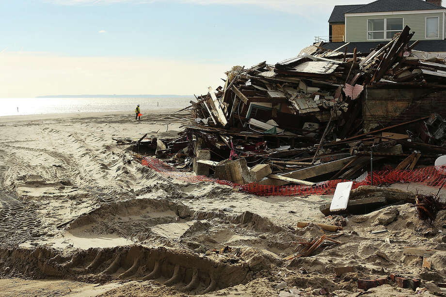 A destroyed home is viewed along the beach in the Belle Harbor neighborhood in the Rockaways on January 2, 2013 in the Queens borough of New York City. Criticism, including by President Barack Obama, has been directed at the Republican House's decision to adjourn without passing a Hurricane Sandy aid bill. According to early estimates, Hurricane Sandy inflicted at least $50 to $60 billion in damage across the Northeast, making it one of the most destructive storms ever. Photo: Spencer Platt, Getty Images / 2013 Getty Images