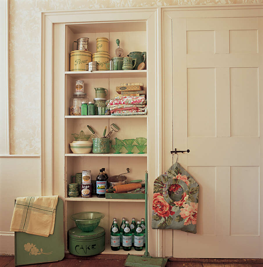 Even in just a small nook, a pantry offers a chance to turn food storage into display. Here vintage tins and utensils mingle with kitchen staples, eliminating the need for the kitchen to be crowded with cabinets. Photo: SUE DALEY AND STEVE GROSS / CREDIT: c. Sue Daley and Steve Gross