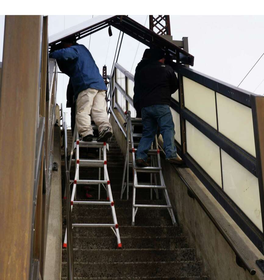 Canopies are being installed over the stairs at the downtown train station. Installation is expectd to take about one week. Photo: Genevieve Reilly / Fairfield Citizen