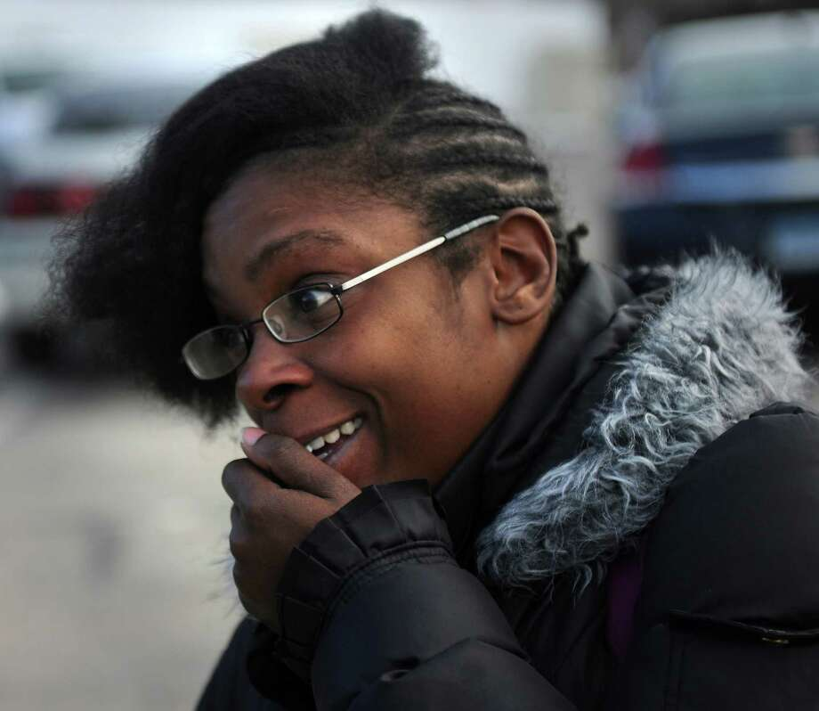 Butler Business School student Ardrena Harris, of Bridgeport, is shocked as she gets off the bus and discovers the school closed at 2710 North Avenue in Bridgeport on Wednesday, January 2, 2012. Photo: Brian A. Pounds / Connecticut Post
