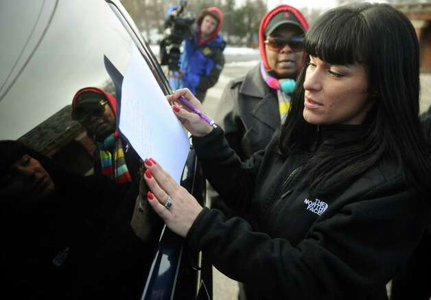 Butler Business School student Kristen Deitz, of Fairfield, signs a petition outside the closed school at 2710 North Avenue in Bridgeport on Wednesday, January 2, 2012. Photo: Brian A. Pounds