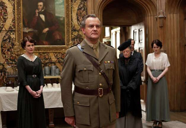 "Elizabeth McGovern (from left), Hugh Bonneville, Maggie Smith and Michelle Dockery star in ""Downton Abbey."" Photo: Associated Press / PBS"
