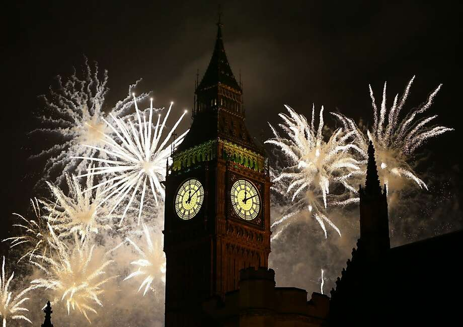 Happy Guy Fawkes Day, er, New Year's! Fireworks explode over Big Ben, ushering in 2013 in London. Photo: Kirsty Wigglesworth, Associated Press