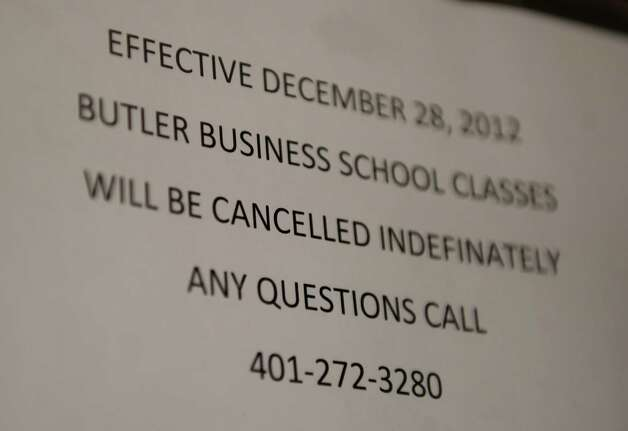 A notice on the door announces the closing of the Butler Business School at 2710 North Avenue in Bridgeport on Wednesday, January 2, 2012. Photo: Brian A. Pounds