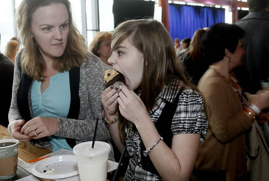 I'm really hungry, Mom!Luanna Stoneback watches her daughter, Casey, inhale a cupcake at a cake-judging contest at the Musikfest Cafe in Bethlehem, Pa. Photo: Stephen Flood, Associated Press