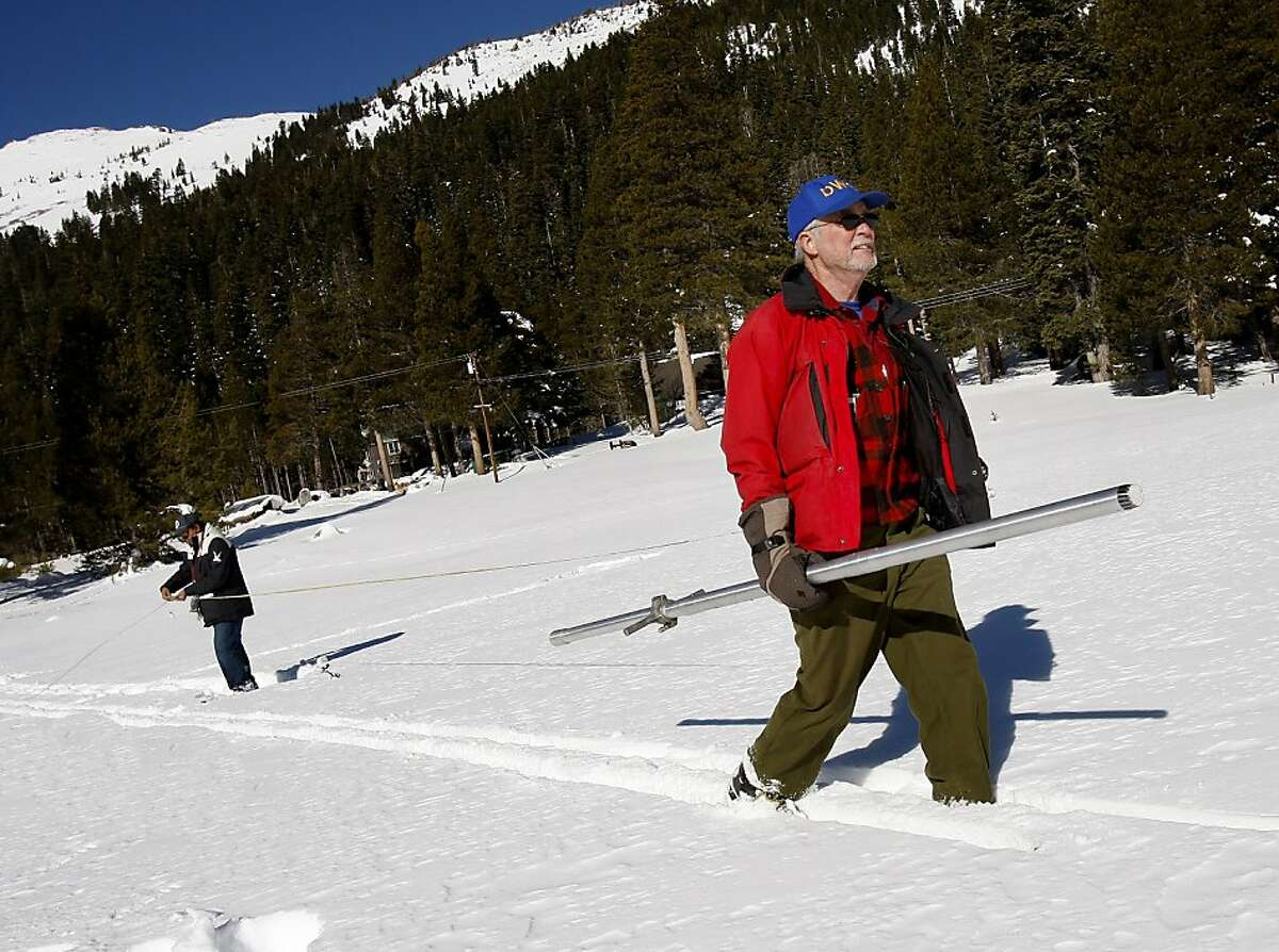 Frank Gehrke (right), head of the state survey team, sets out with his snow depth tube in Phillips meadow. The first snow survey of the new year Wednesday January 2, 2013 found slightly above averages of snow and water content in the Phillips, Calif. meadow near Echo Summit.