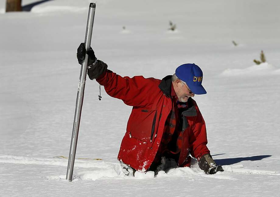 Frank Gehrke, chief snow surveyor for the California Department of Water Resources, smiles after falling off his cross-country skis while taking a snow measurement at Phillips Station. Photo: Brant Ward, The Chronicle