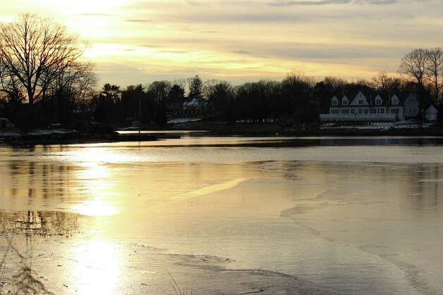 Water near the bridge that leads to Pear Tree Point Road froze over Wednesday due to cold temps. Jan. 2, 2013. Photo: Megan Davis