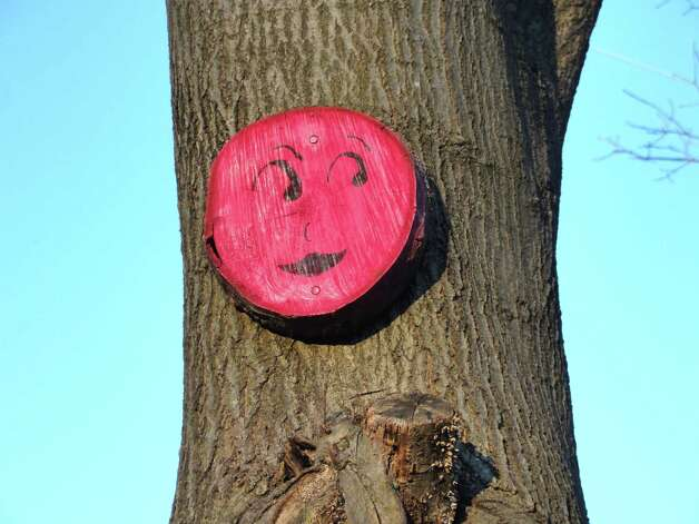 This pink smiley face has its eyes on Drinkwater Lane by the railroad overpass. Photo: Contributed Photo