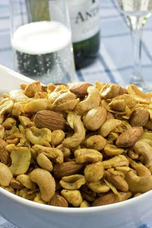 Mixed nuts instead of potato chips: If you're going to snack on something fatty and salty, nuts are a much better option. Yes, they're both pretty high in fats and calories, but 1 ounce of nuts contains 4.9 grams of protein, compared to 1.86 grams for the chips. Also, nuts have three times as much monounsaturated fat (the good kind) as polyunsaturated fat, while chips have the same of both. Photo: Larry Crowe, AP / FR41490 AP