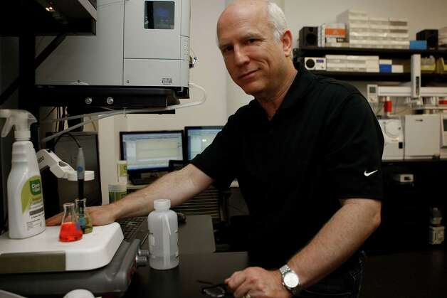 Stanford trained physician Dr. Larry Weiss working in his lab at the CleanWell office in San Francisco, California, on Friday,  December 21, 2012.  CleanWell creates soaps, hand sanitizers, disinfectants, fabric deodorizers and bathroom cleaners leaving out triclosan, a chemical widely used in antibacterial hand soaps.  The FDA proposed banning triclosan in the 1970's. Photo: Liz Hafalia, The Chronicle / SFC