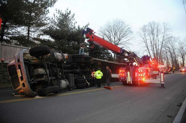 A tractor-trailer traveling near Bimbo Bakeries on Hamilton Avenue rolled over Wednesday afternoon, Jan. 2, 2013, blocking traffic in both directions. The accident happened around 3:30 p.m. in Chickahominy and did not cause any injuries. Photo: Helen Neafsey / Greenwich Time