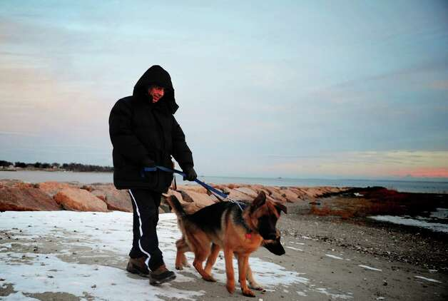 Patrick Karanfilovic, of Norwalk, walks his dogs, Besko and Icko, at Southport Beach Wednesday, Jan. 2, 2013. Photo: Autumn Driscoll / Connecticut Post