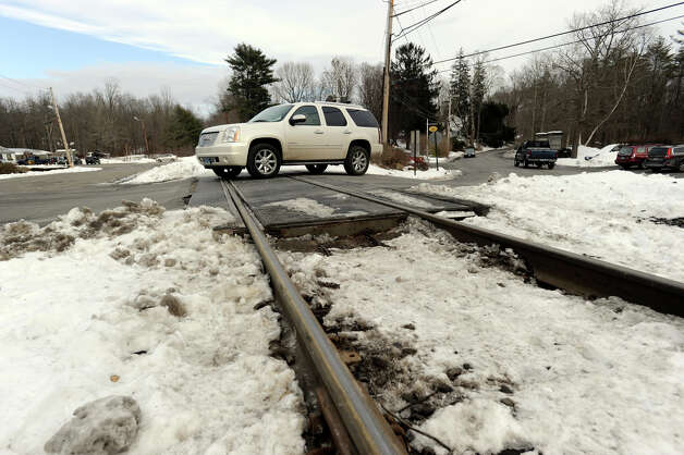 A car crosses railroad tracks near the West Redding railroad station Wednesday, where another train hit a car Sunday, killing one and injuring three others. Photo: Carol Kaliff / The News-Times