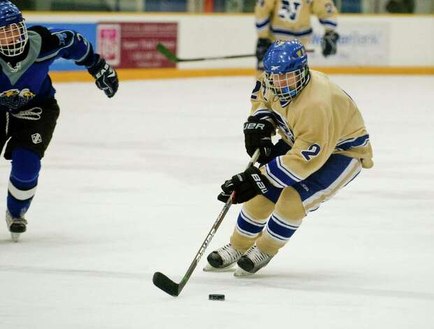 Newtown High School's Parker Rodbell brings the puck into the East Catholic High School offensive zone in a game at the Danbury Arena. Wednesday, Jan. 2, 2013 Photo: Scott Mullin